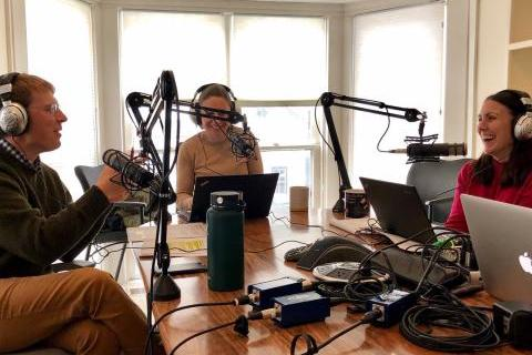 Three professors in the podcast studio recording an episode about The Farm Bill